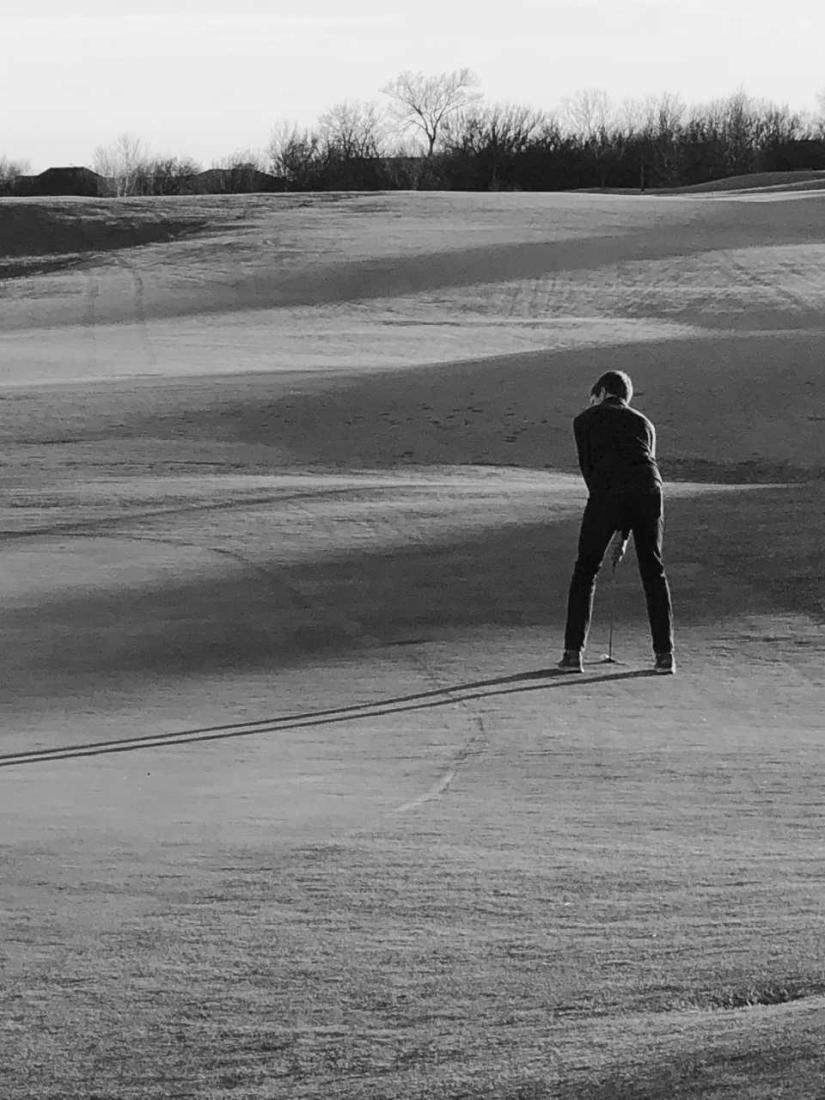 JAck golfing